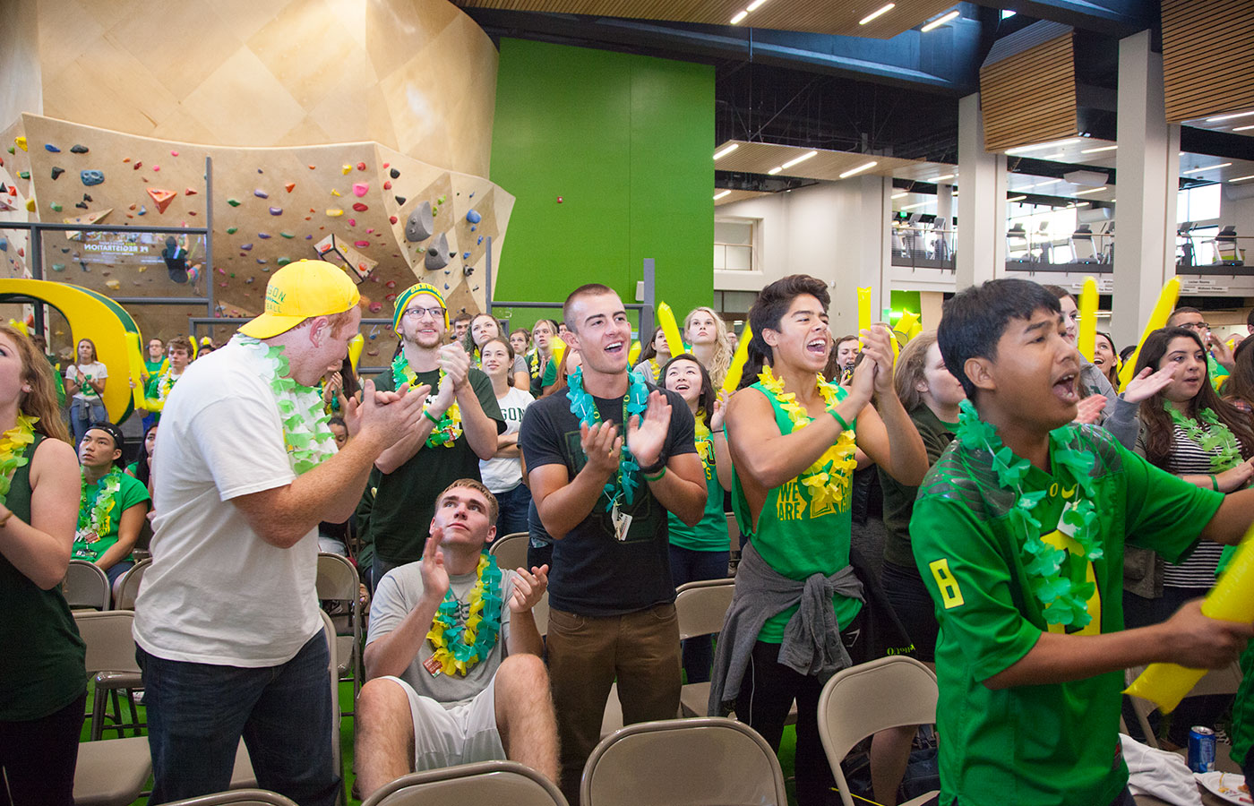 Students yell with excitement during a Ducks watch party in the Student Recreation Center.