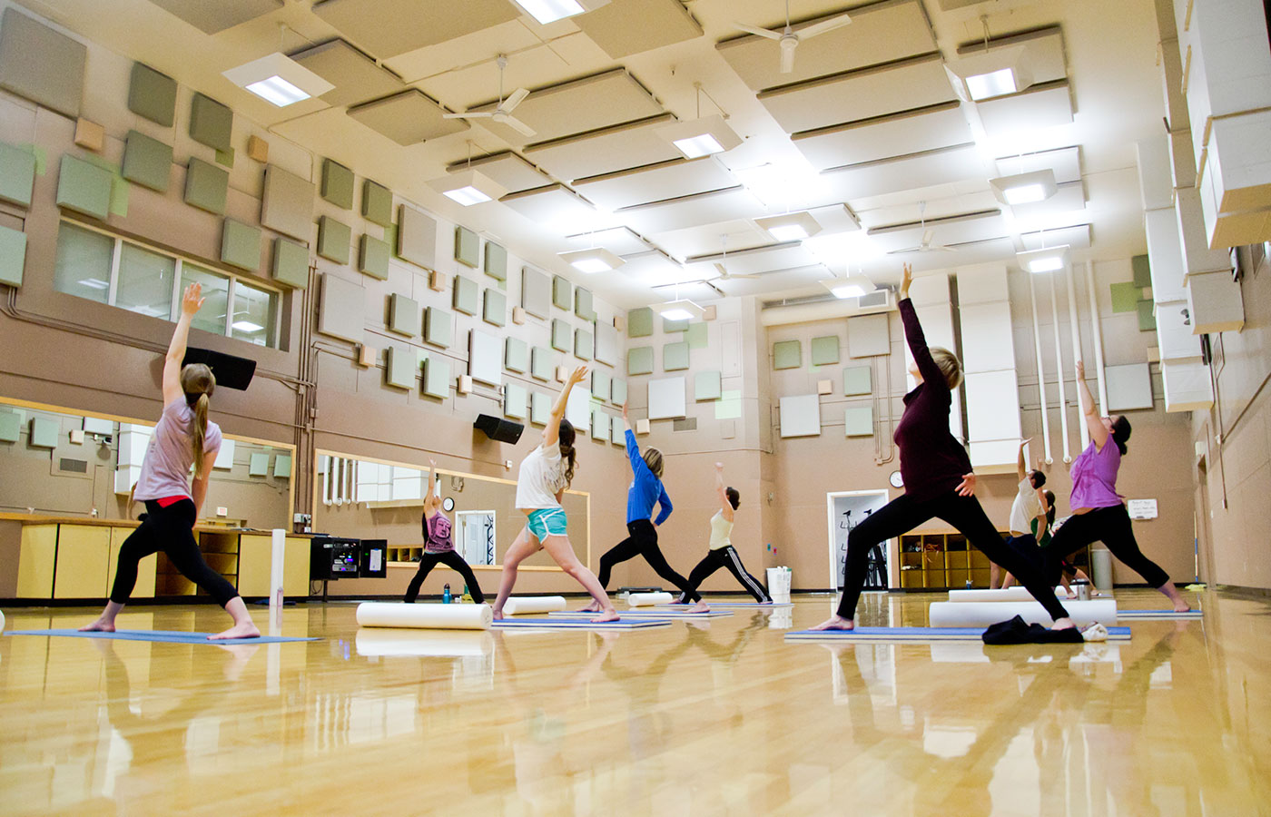 Students doing reverse warrior pose in a yoga class in the Student Recreation Center.
